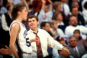 University of Connecticut women's basketball Coach Geno Auriemma encourages star player Rebecca Lobo during a game Storrs CT January 1995