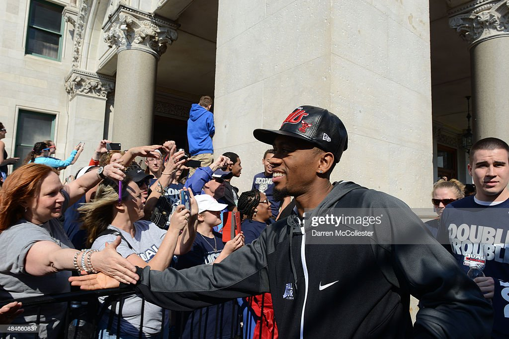 University of Connecticut's Ryan Boatright takes part in a victory parade April 13, 2014 in Hartford, Connecticut. Both the men's and women's Huskies basketball teams won national championships, marking the second time they have done so.