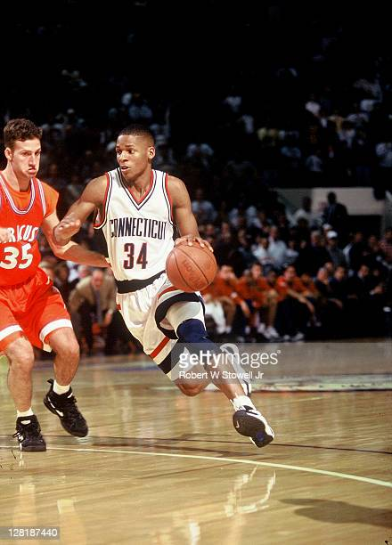 University of Connecticut's star guard Ray Allen drives past a defender during a game against Big East rival Syracuse Hartford CT 1995