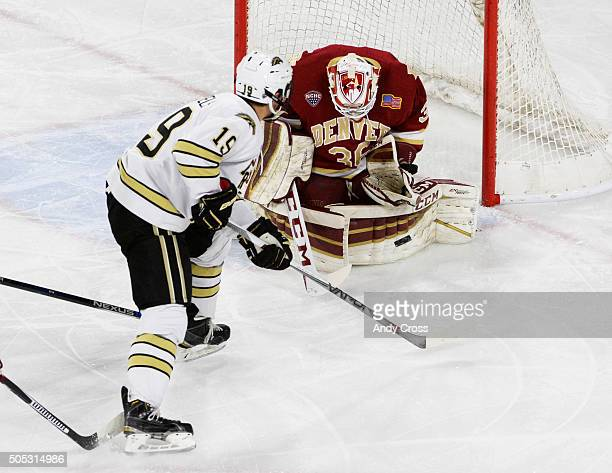 University of Denver Pioneers goalie Tanner Jaillet has a puck shot by Western Michigan Broncos forward Frederik Tiffels bounce out of his glove in...