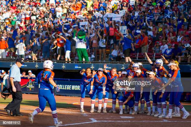 University of Florida players wait for Sophia Reynoso of the University of Florida at home plate during Game 2 of the Division I Women's Softball...