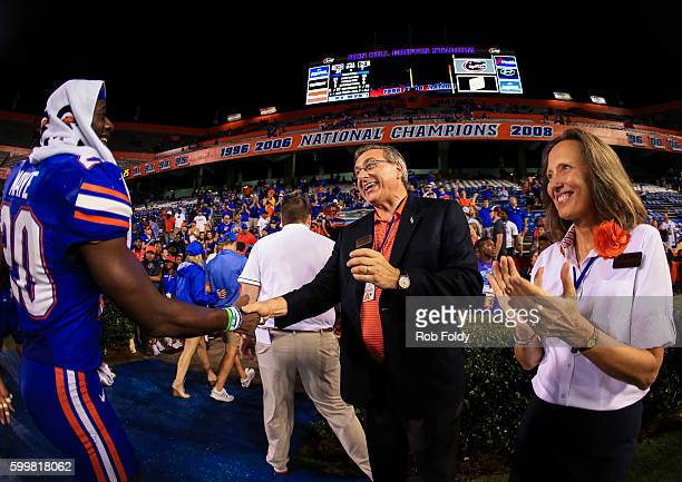 University of Florida president W Kent Fuchs shakes hands with Marcus Maye of the Florida Gators after the game against the Massachusetts Minutemen...