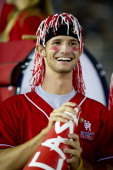 University of Houston Cougars fan cheers with the crowd before the start of the first half of the game against the University of California Los...