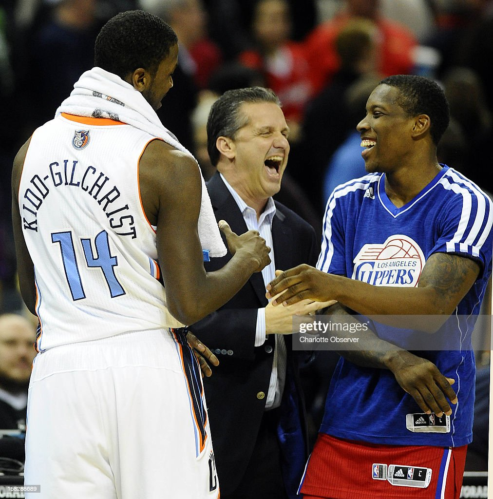 University of Kentucky head coach John Calipari, center, jokes with former players, the Charlotte Bobcats' Michael Kidd-Gilchrist (14) and Los Angeles Clippers' Eric Bledsoe, after their game at Time Warner Cable Arena in Charlotte, North Carolina, on Wednesday, December 12, 2012. The Clippers won, 100-94.