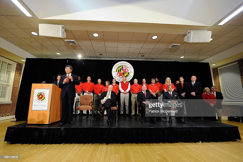 University of Maryland President Wallace D. Loh announces Maryland's decision to join the Big Ten Conference during a press conference on November 19, 2012 in College Park, Maryland. Seated to his right are University System of Maryland Chancellor Brit Kirwan, Big Ten Commissioner James E. Delany, and Director of Athletics Kevin Anderson.