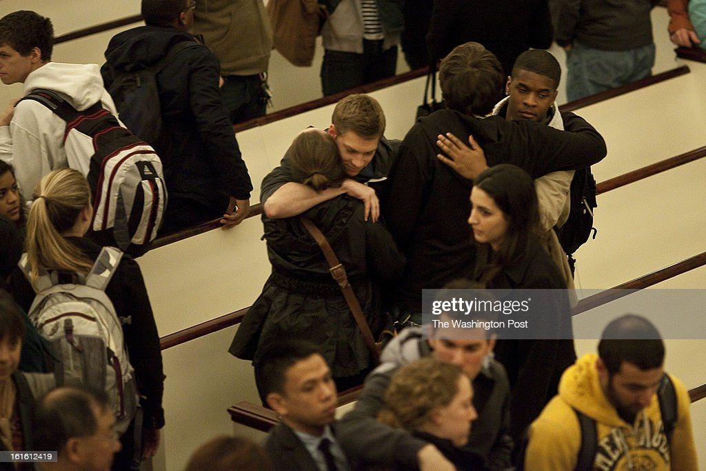 University of Maryland students embrace at the conclusion of a vigil at the Memorial Chapel on campus in College Park, Maryland Tuesday February 12, 2013. A University of Maryland graduate student shot two housemates, one fatally, then turned the gun on himself earlier in the day at their College Park home.