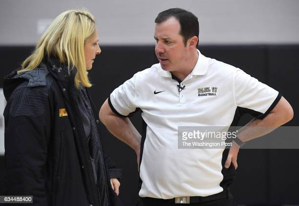 University of Maryland women's basketball coach Brenda Frese talks with Paul VI Panthers head coach Scott Allen after the game with the Good Counsel...
