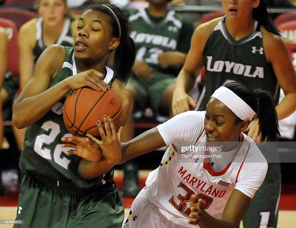 University of Maryland's Shatori Walker-Kimbrough looked to steal the rebound from Loyola's Brittany Butler in the first half at Comcast Center on Sunday, November 10, 2013 in College Park, Md.