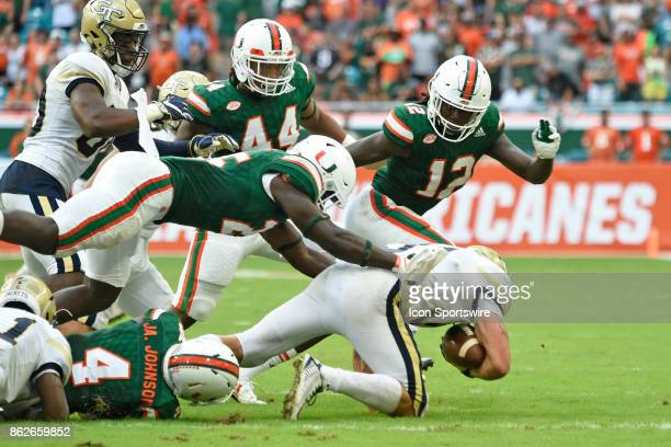 University of Miami defensive back Derrick Smith tackles Georgia Tech Aback Nathan Cottrell during an NCAA football game between the Georgia Tech...