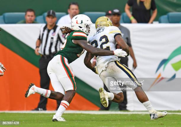 University of Miami defensive back Malek Young tackles Georgia Tech Aback Clinton Lynch during an NCAA football game between the Georgia Tech Yellow...