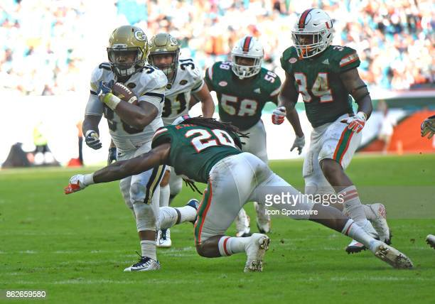 University of Miami defensive back Robert Knowles tackles Georgia Tech Bback KirVonte Benson during an NCAA football game between the Georgia Tech...