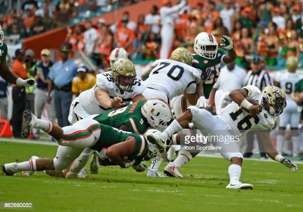 University of Miami defensive lineman Chad Thomas and defensive lineman Trent Harris sack Georgia Tech quarterback TaQuon Marshall during an NCAA...