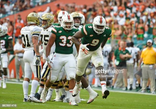 University of Miami defensive lineman Chad Thomas and defensive lineman Trent Harris celebrate their sack during an NCAA football game between the...