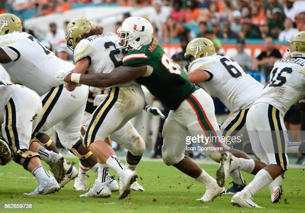 University of Miami defensive lineman RJ McIntosh tackles Georgia Tech B back Quaide Weimerskirch during an NCAA football game between the Georgia...