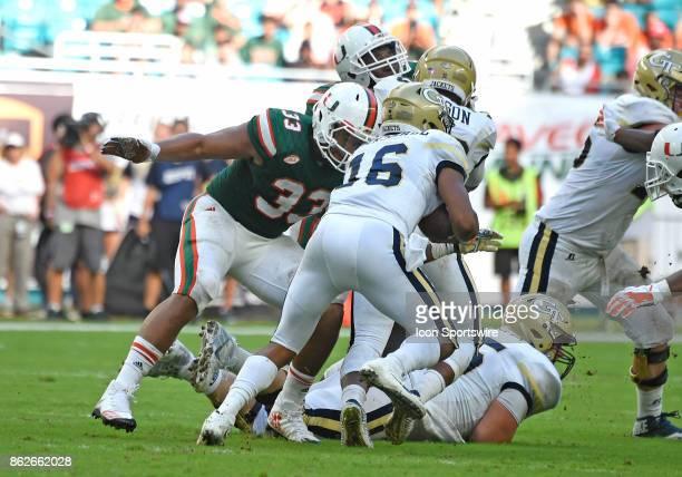 University of Miami defensive lineman Trent Harris tackles Georgia Tech quarterback TaQuon Marshall during an NCAA football game between the Georgia...