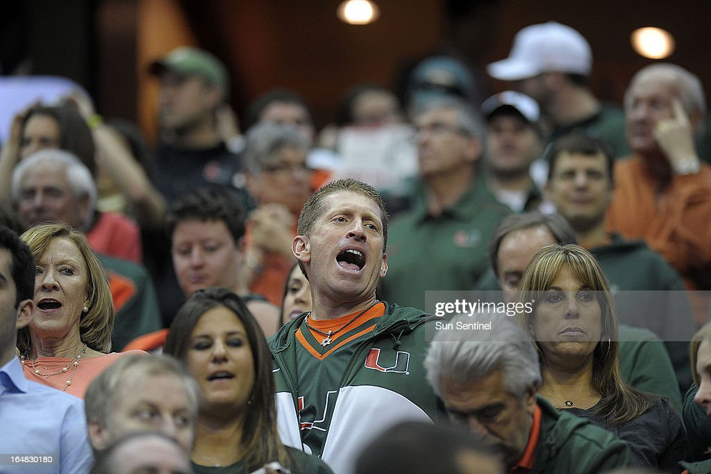 University of Miami fans cheer for the Hurricanes as they enter the court to play Marquette in an NCAA Tournament East Regional semifinal at the Verizon Center in Washington, D.C., Thursday, March 28, 2013.