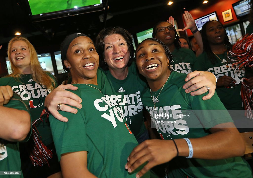 University of Miami head basketball coach Katie Meier, center, celebrates with players Adrienne Motley and Jessica Thomas and their teamamtes on Monday, March 13, 2017 as they realize they will be playing at home in the NCAA women's basketball tournament.