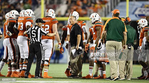 University of Miami Hurricanes Head Coach Mark Richt calls a timeout and gets the teams attention during the Russell Athletic Bowl game between the...