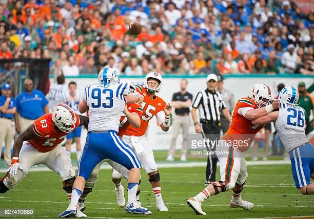 University of Miami Hurricanes Quarterback Brad Kaaya throws the ball as University of Miami Hurricanes Offensive Lineman Danny Isidora University of...