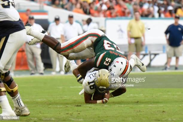 University of Miami linebacker Zach McCloud tackles Georgia Tech quarterback TaQuon Marshall during an NCAA football game between the Georgia Tech...