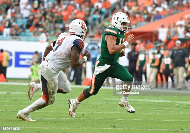 University of Miami quarterback Malik Rosier is pursued by Syracuse linebacker Zaire Franklin during an NCAA football game between the Syracuse...