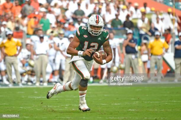 University of Miami quarterback Malik Rosier runs during an NCAA football game between the Georgia Tech Yellow Jackets and the University of Miami...