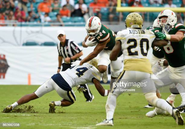 University of Miami running back Travis Homer runs as Georgia Tech defensive back Corey Griffin attempts the tackle during an NCAA football game...