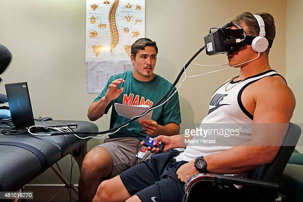 University of Miami Sports Medicine research volunteer Tyler Waner gives football player Braxton Berrios instructions during testing with concussion...