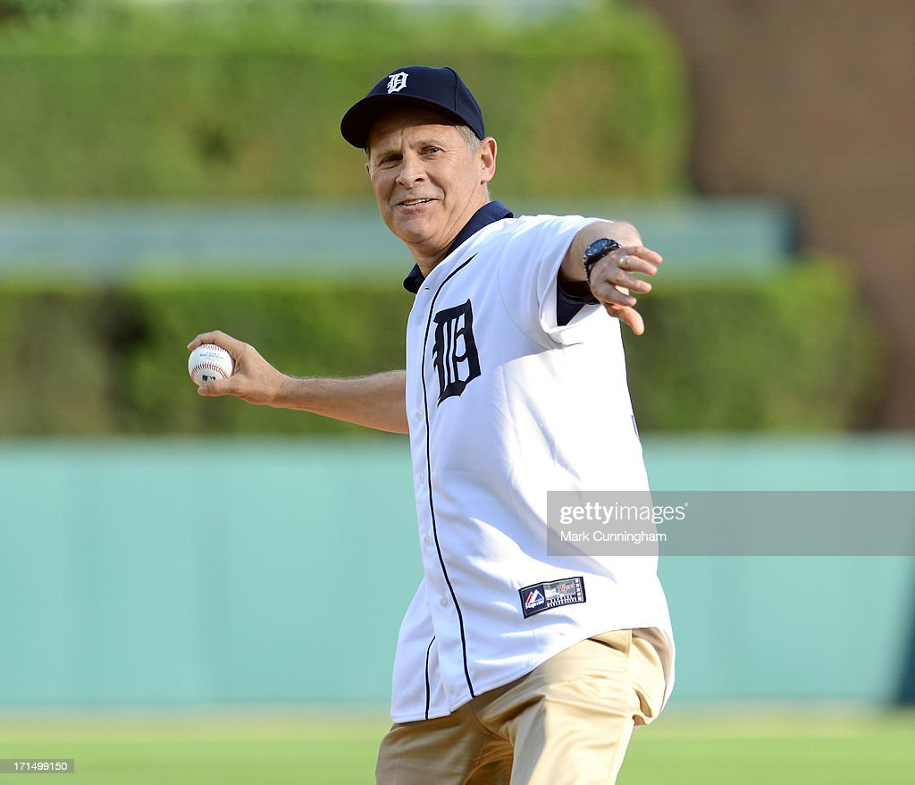 University of Michigan head basketball coach John Beilein throws out the ceremonial first pitch prior to the game between the Detroit Tigers and the Baltimore Orioles at Comerica Park on June 18, 2013 in Detroit, Michigan. The Orioles defeated the Tigers 5-2.