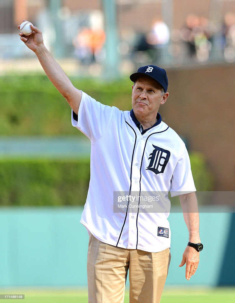 University of Michigan head basketball coach John Beilein waves to the crowd before throwing out the ceremonial first pitch prior to the game between the Detroit Tigers and the Baltimore Orioles at Comerica Park on June 18, 2013 in Detroit, Michigan. The Orioles defeated the Tigers 5-2.