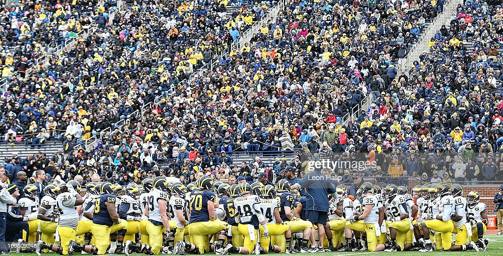 University of Michigan head coach Brady Hoke talks with his team prior to the start of the annual Spring Game at Michigan Stadium on April 13, 2013 in Ann Arbor, Michigan.
