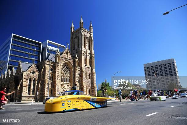 University of Michigan Solar Car Team vehicle 'Novum' from the United States of America competes during a street parade for the 2017 Bridgestone...