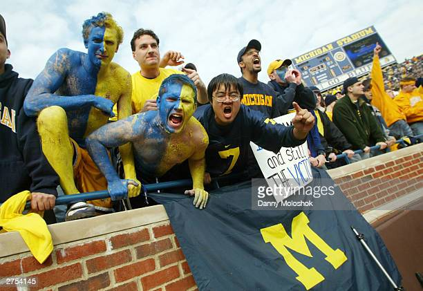 University of Michigan students and fans cheer before the 100th meeting between the Michigan Wolverines and the Ohio State Buckeyes November 22 2003...