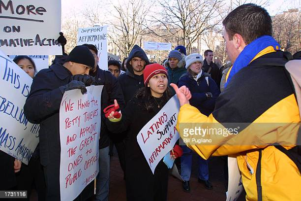 University of Michigan students argue both sides of their university's admissions policy at a protest rally at the University of Michigan January 17...