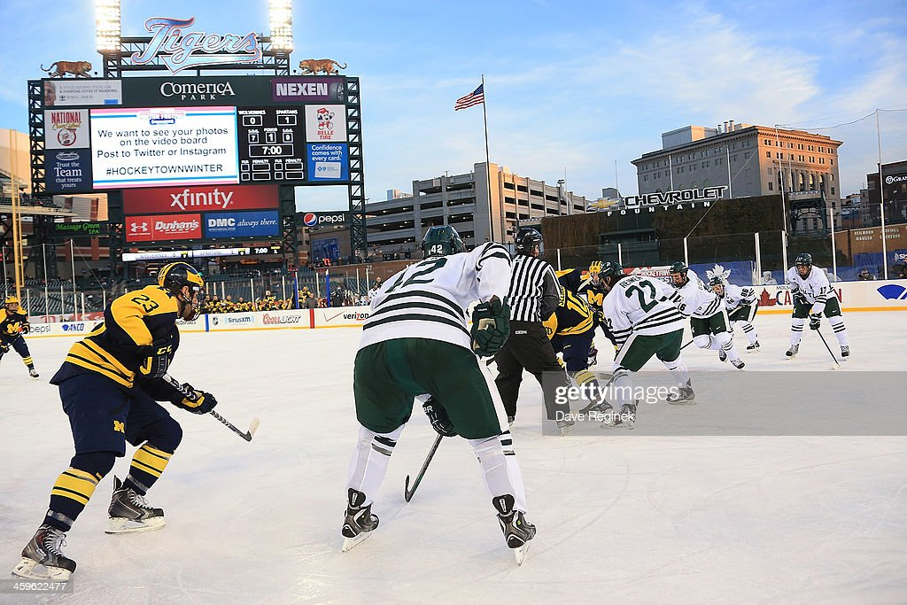 University of Michigan Wolverines faces off against the Michigan State Spartans during the consolation game of the Hockeytown Winter Festival Great Lakes Invitational - Day 2 played outdoors at Comerica Park on December 28, 2013 in Detroit, Michigan.