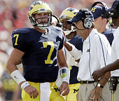 University of Michigans Chad Henne talks with head Coach Lloyd Carr during a first quarter time out against Northern Illinois at Michigan Stadium on...