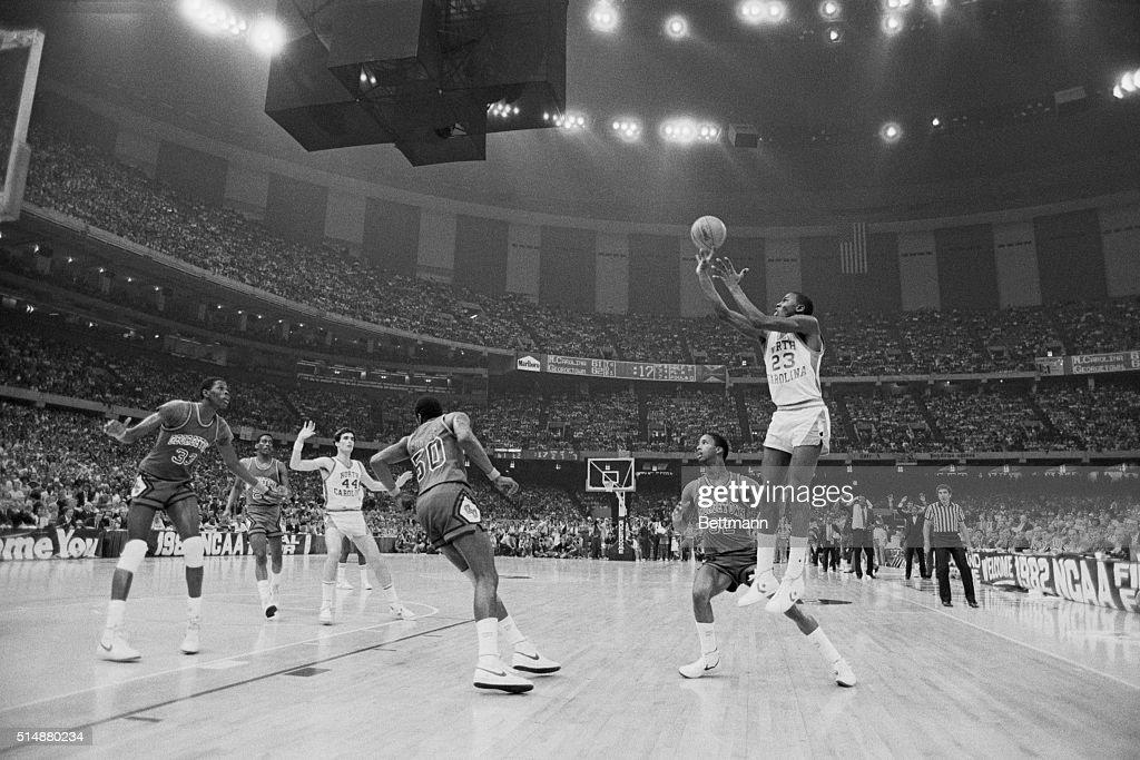 University of North Carolina basketball player Michael Jordan shoots the winning basket in the 1982 NCAA Finals against Georgetown University