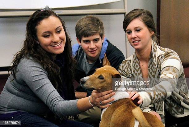 University of North Carolina freshmen Laura Gamo leftright along with Lucas John and sophomore Haley Ross pet Mickey an 11 year old basenji at Park...
