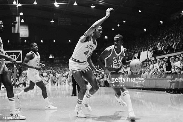 University of North Carolina guard Michael Jordan wags his tongue as he dribbles the basketball past a North Carolina State defender January 13 1982