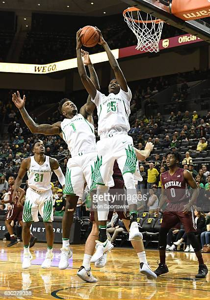 University of Oregon senior forward Chris Boucher and University of Oregon junior forward Jordan Bell go up for a rebound during a nonconference NCAA...