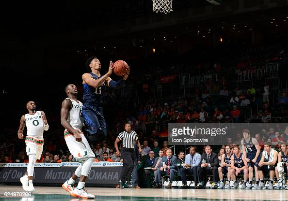 University of Pennsylvania guard Tyler Hamilton shoots during an NCAA basketball game between the University of Pennsylvania Quakers and the...