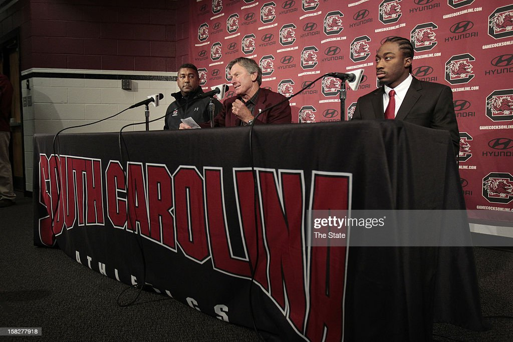 University of South Carolina running back Marcus Lattimore announces Wednesday, December 12, 2012, his intentions to enter the NFL draft during a press conference in Columbia, South Carolina. Orthopedist Dr. Jeff Guy, left, and head coach Steve Spurrier joined Lattimore at the announcement.