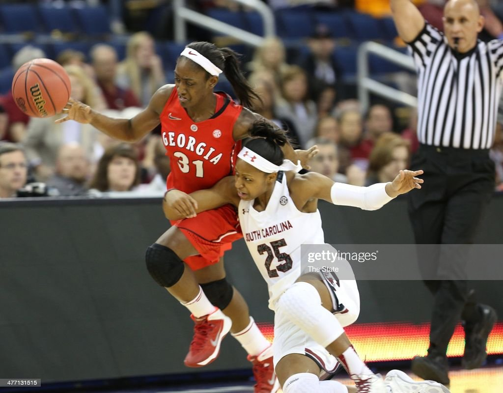 University of South Carolina's Tiffany Mitchell fights for a ball with Georgia's Erika Ford during the first half of SEC tournament play at The Arena...