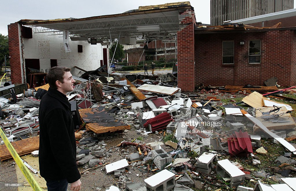University of Southern Mississippi student Ryan Raziano views the damage at the Jazz Station building on Monday, February 11, 2013, after Sunday's tornado hit Hattiesburg, Mississippi. Sixty-three people were injured in the storm.