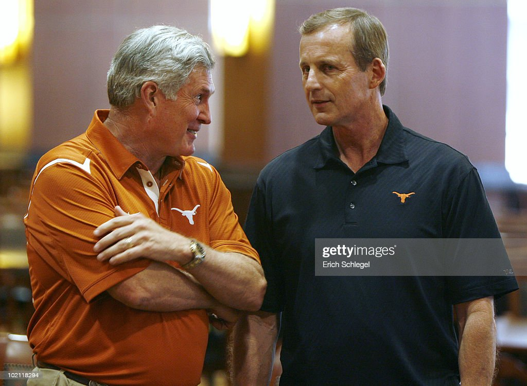 University of Texas at Austin football head coach Mack Brown, left, and men's head basketball coach Rick Barnes talk before a press conference in which university officials announce the athletics programs will continue competing in the Big 12 Conference June 15, 2010 in Austin, Texas.