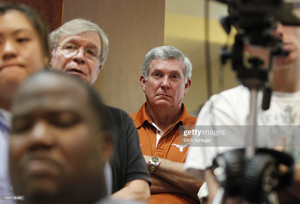 University of Texas at Austin football head coach Mack Brown listens as university officials announce the athletics programs will continue competing in the Big 12 Conference June 15, 2010 in Austin, Texas.
