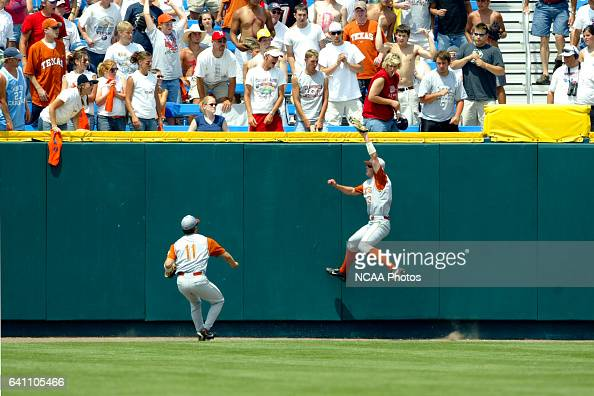 University of Texas centerfielder Drew Stubbs climbs the wall to take away a Cal State Fullerton homerun during the Division I Men's Baseball...