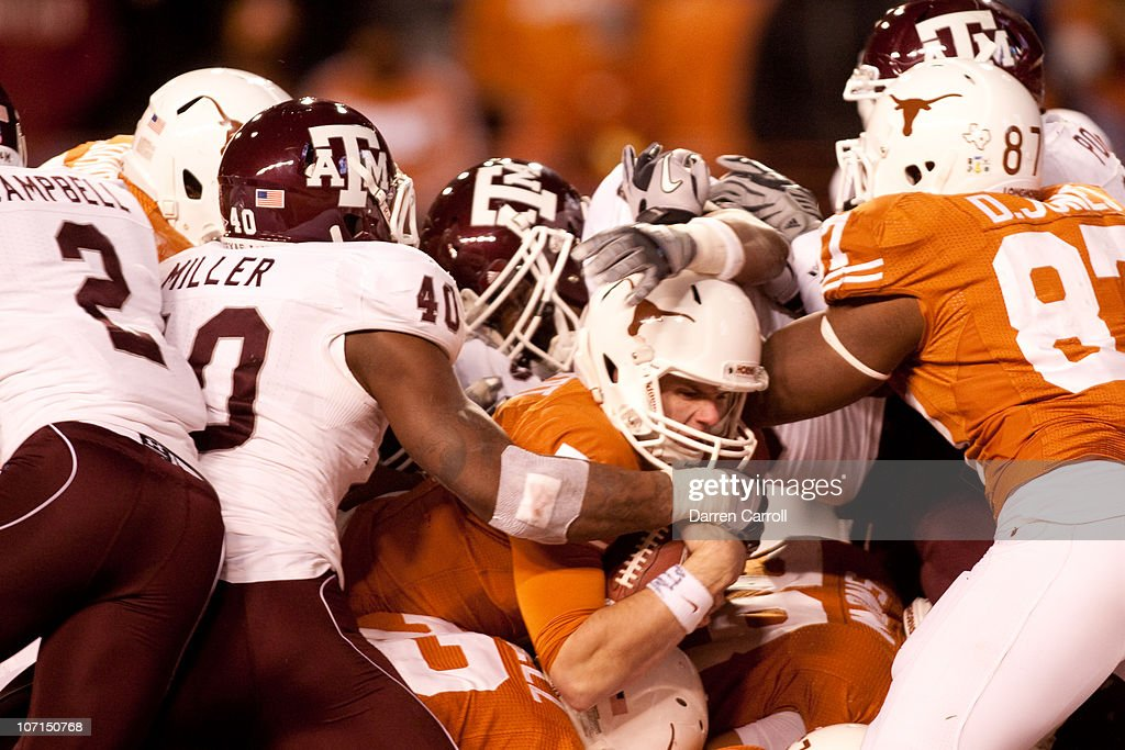University of Texas quarterback <a gi-track='captionPersonalityLinkClicked' href=/galleries/search?phrase=Garrett+Gilbert&family=editorial&specificpeople=5652883 ng-click='$event.stopPropagation()'>Garrett Gilbert</a> #7 scores a touchdown during the second half against Texas A&M at Darrell K. Royal-Texas Memorial Stadium on November 25, 2010 in Austin, Texas.