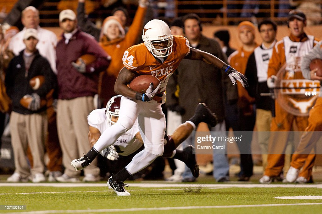 University of Texas wide receiver Marquise Goodwin #84 eldues Texas A&M safety <a gi-track='captionPersonalityLinkClicked' href=/galleries/search?phrase=Trent+Hunter&family=editorial&specificpeople=202047 ng-click='$event.stopPropagation()'>Trent Hunter</a> #1 during a touchdown reception in the first half at Darrell K. Royal-Texas Memorial Stadium on November 25, 2010 in Austin, Texas.