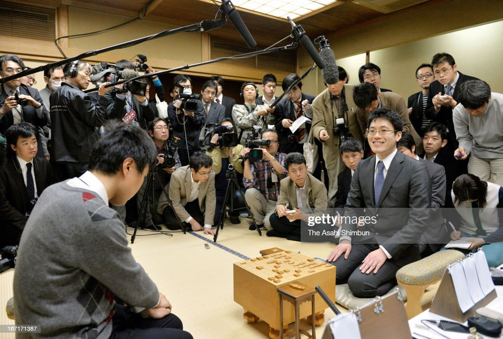 University of Tokyo associate professor Tomoyuki Kaneko (R) smiles after computer program 'GPSShogi', developed by his team beating A-class professional player Hiroyuki Miura (L) in the last match of Shogi Master Versus Machine Match series at Shogi Kaikan on April 20, 2013 in Tokyo, Japan.